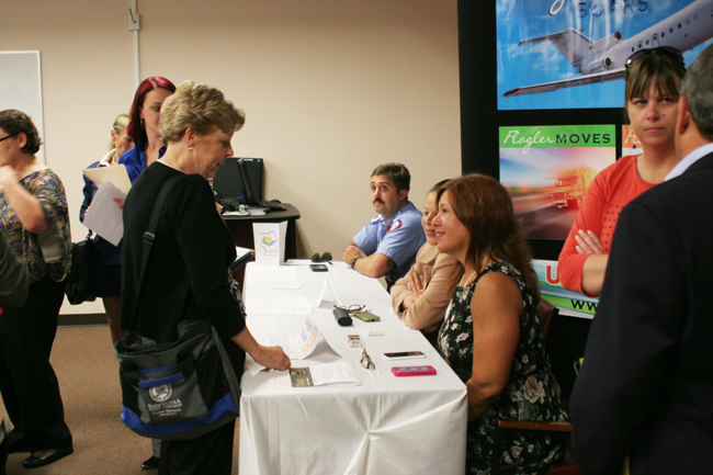 Employers and applicants filled a chamber at the county's Emergency Operations Center Thursday for a job fair. In red, to the right, is Rebecca DeLorenzo, president of the Flagler County Chamber of Commerce. (Flagler County)
