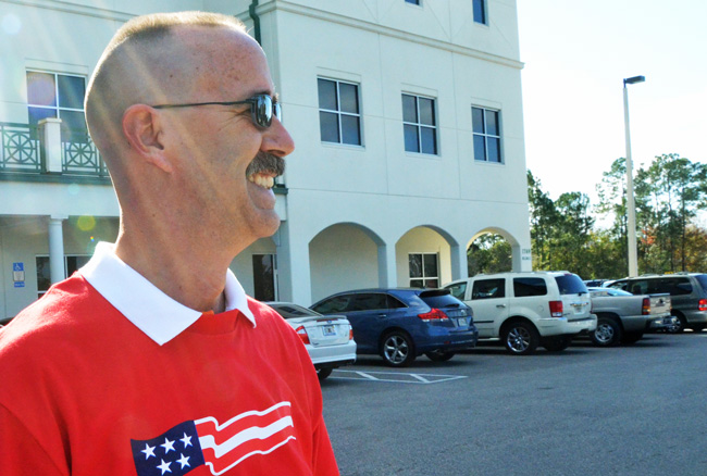 Flagler County Sheriff's deputy Joseph Delarosby had served nearly 20 years in the force. Seen here in a January 2012 image at the Government Services Building, where he was off duty, Delarosby was instantly recognizable from his broad smile and lanky frame. (© FlaglerLive)