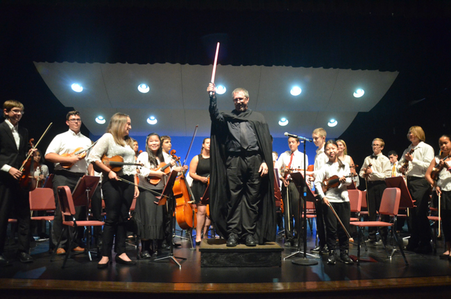 Conductor Joe Corporon at the end of a performance of the Star Wars theme at last May's concert. The Force, and the entire Flagler Youth Orchestra, are back Wednesday for their first full-scale performance of the year at the Flagler Auditorium. (c FlaglerLive)