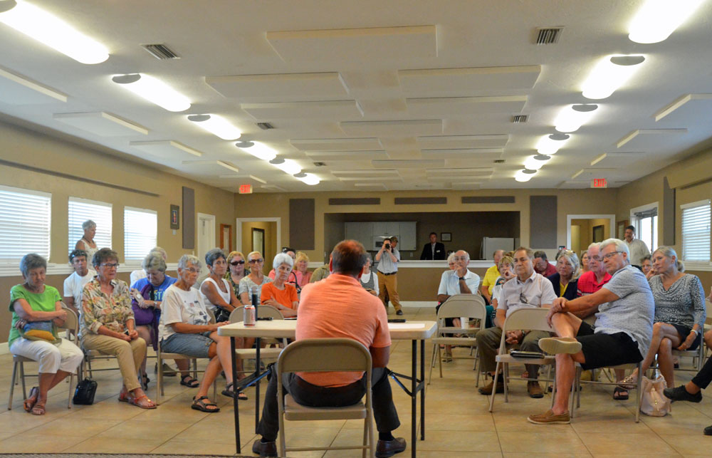 County Commissioner Joe Mullins faces the Hammock Community Association and others at a town hall meeting he called Monday evening. (© FlaglerLive)