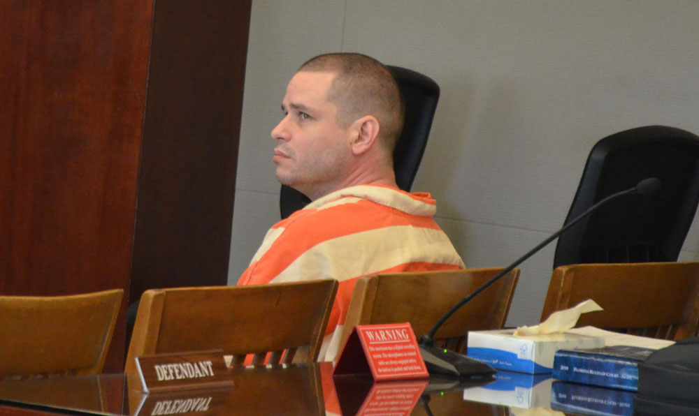 Keith Johansen in court Friday. He faces a first-degree murder charge in a trial that starts in two weeks. (© FlaglerLive)