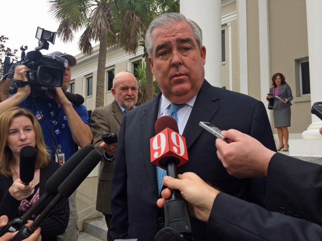 Attorney John Morgan, a chief backer of a proposed amendment to legalize medical marijuana in Florida, speaks to reporters outside the Florida Supreme Court after justices heard arguments on whether to allow the wording of the proposal to make it to the November 2014 ballot. (Brandon Larrabee)