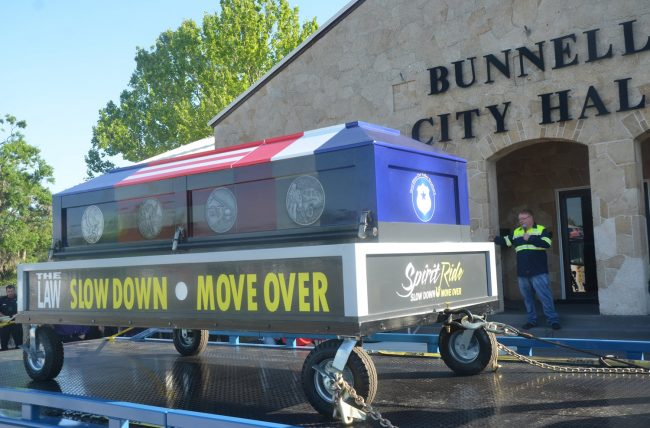 John Rogers, Bunnell's vice mayor and long-time owner of John's Towing, this morning emceed the Spirit Ride ceremony's stop in the city before towing the ceremonial casket to its next stops in Deltona and Heathrow. (© FlaglerLive)
