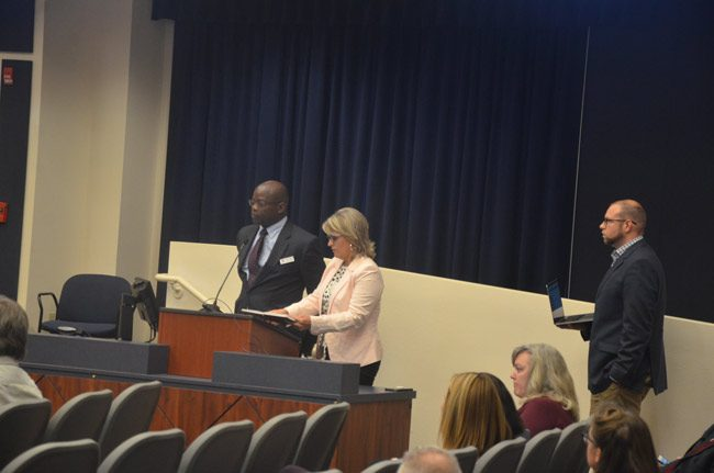 Earl Johnson, left, the district's point man on the Social Sentinel contract, the company's Heather, a sales director, and technology director Ryan Diesing, speaking to the school board Tuesday evening. (© FlaglerLive)