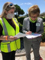 Tax Collector Suzanne Johnston, right, during the visits to property owners along A1A in mid-May. (Flagler County)