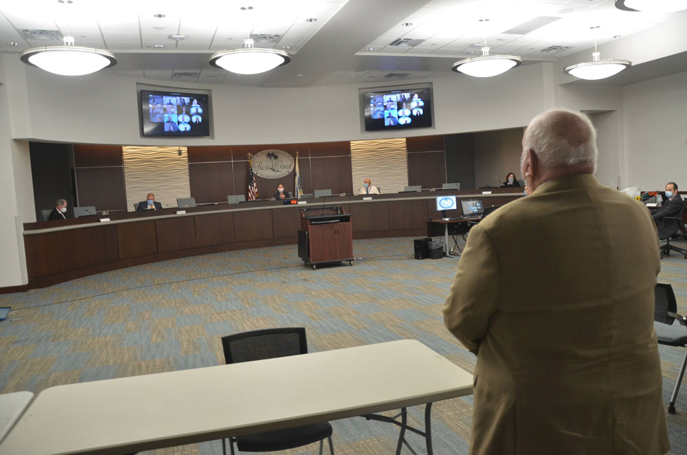 The comeback kid: Jon Netts prepares to take his place, again , on the Palm Coast City Council after the council voted 4-0 this evening to appoint him to the seat Jack Howell resigned last month. (© FlaglerLive)