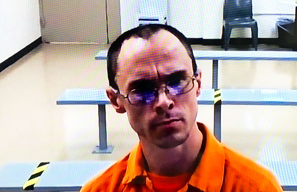 Jonathan Canales appeared for his hearing by video from the Flagler County jail, though he was bused in from prison in DeSoto County. (© FlaglerLive)