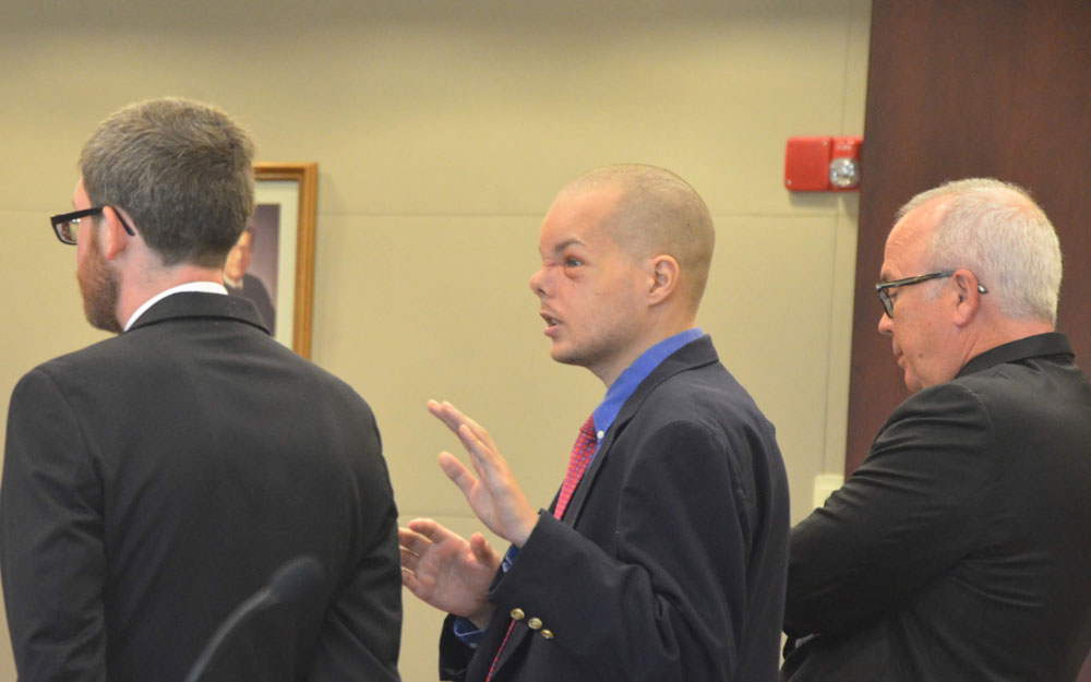 Joseph Bova, flanked by his attorneys--Joshua Mosley, left, and Matt Phillips--as he strenuously argued with Circuit Judge Perkins that he wanted to represent himself. Perkins denied the request. Bova eventually won the argument as an appeals court today ruled that the judge was wrong to deny his right to self-representation. (© FlaglerLive)