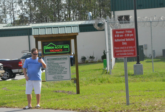 Palm Coast attorney Josh Davis has been critical of Sheriff Staly's folksy ways, such as the nick-naming of the county jail as the 'Green Roof Inn.' Davis considers the sheriff's approach prejudicial to defendants who've yet to be tried. (© FlaglerLive)
