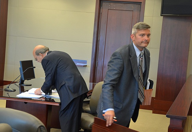 Josh Knight, the attorney who ended up on the losing end of two frivolous lawsuits, was not in court Wednesday when Al Hadeed, the county attorney, to the left, was awarded legal fees in the latest case. (© FlaglerLive)