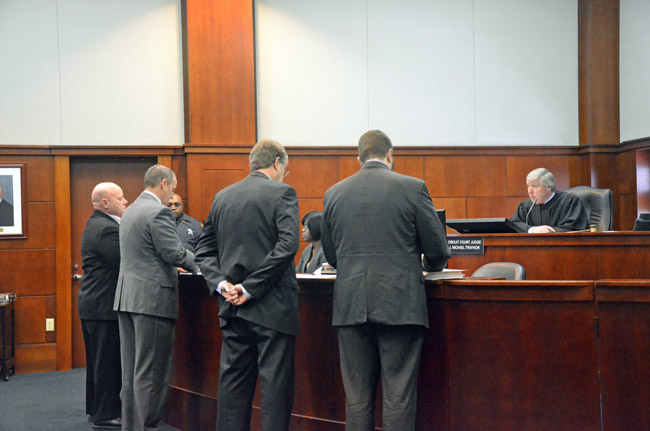 Circuit Judge J. Michael Traynor addressing the prosecution and the defense during the sentencing hearing of Nathaniel Juratovac (far left) in a St. Augustine courtroom in late January. (© FlaglerLive)