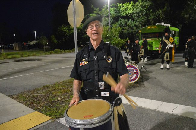 Look who joined Coastal Florida Police and Fire Pipes and Drums, the popular group of performers often seen at ceremonially solemn functions around town, from commemorations of Memorial or Veterans Day to--as was the case Monday--fallen officers memorials: it's Circuit Judge J. David Walsh, who retired from Flagler's felony bench in 2016, but who's been busy since, putting in duty as a retired judge at the courthouse. Walsh says he's always been a drummer and was eager to get back to it. (© FlaglerLive)