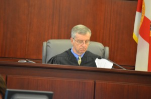 Flagler County Circuit Judge J. David Walsh, who had presided over the week-long trial with a distinctly unassuming touch, reviewed the verdict before it was announced. Click on the image for larger view. (© FlaglerLive)