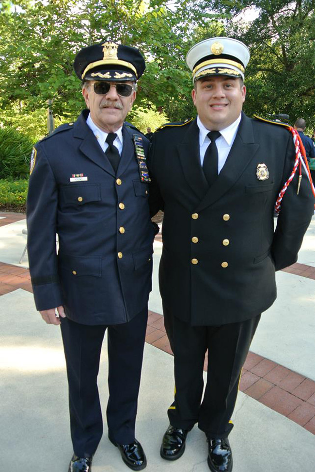The Palm Coast Fire Department's Patrick Juliano, right, who organized the 9/11 ceremony, with Ronnie Young, a retired Major with the New York State Court Police, which lost three officers on 9/11.
