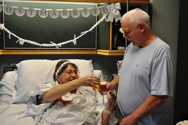 Julia Roberts and Terry Adolph drink up to their wedding vows, 17 years into their courtship, at Florida Hospital Flagler. (FHF)