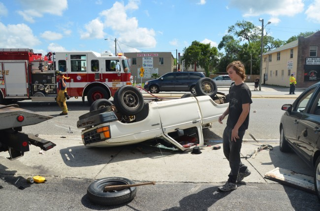 Kaenin Brinkley, 18, can consider himself lucky: only his toe hurt, and he had a bump on the head, after his truck overturned, almost crushing him on the driver's side but for his ducking, in a two-vehicle collision Tuesday. Click on the image for larger view. (© FlaglerLive)