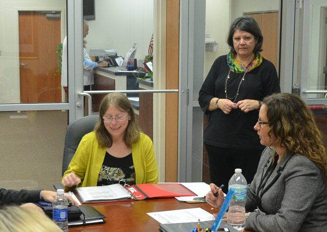 Kaiti Lenhart, left, Flagler County's supervisor of Elections, in a canvassing board meeting soon after she took over the elections office in January 2015 by appointment. She was elected supervisor in August. Sitting to her right was Judge Melissa Moore-Stens, who chairs the canvassing board. (© FlaglerLive)