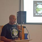 Ken Bryan, addressing the audience at the November 7 meeting on The Gardens. Bryan is the target of a defamation lawsuit by The Gardens' umbrella company, SunBelt Land Management. (© FlaglerLive)