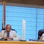 Flagler Beach City Commissioner Ken Bryan, setting up the discussion of The Gardens development at the commission's last meeting earlier this month. Mayor Linda Provencher is to the right. (© FlaglerLive via YouTube)