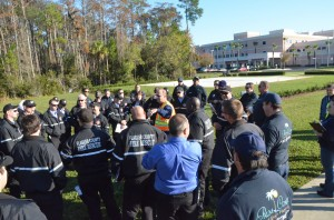 Emergency Services Director Kevin Guthrie, in the center, briefs the responders just before the start of the exercise. Click on the image for larger view. (© FlaglerLive)
