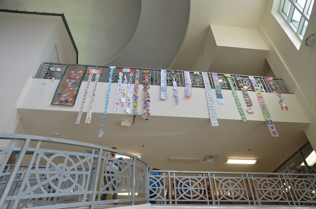 The Government Services Building this week took on a more youthful feel as the Early learning Coalition decorated the lobby with art work by children ahead of Florida Children's Week starting March 24 in Tallahassee, where the art work will be displayed. (© FlaglerLive)