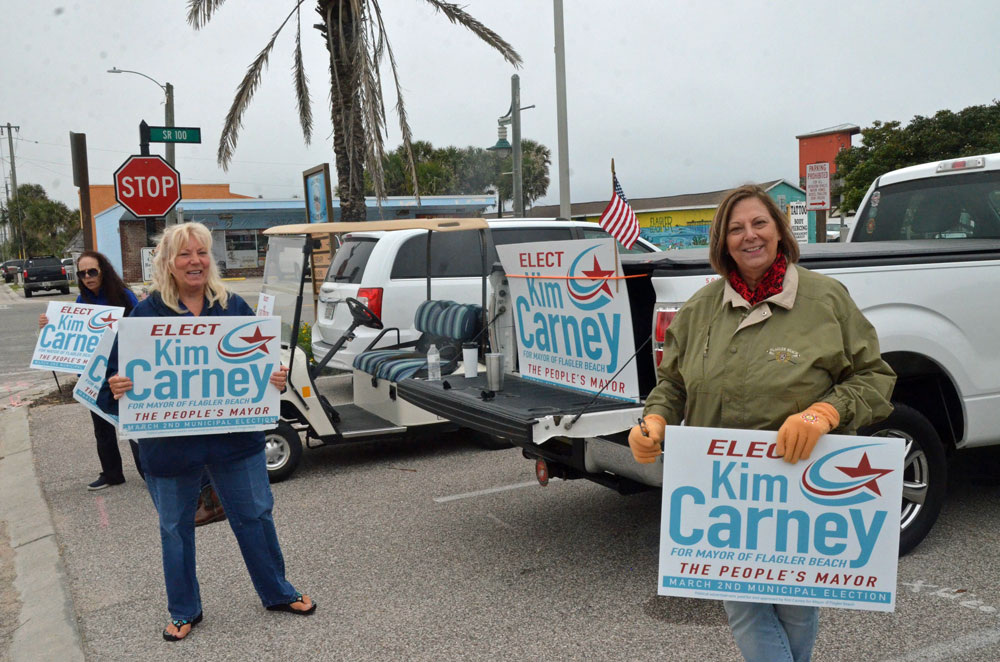 Kim Carney, right, with volunteer Elaine Winter. (© FlaglerLive)