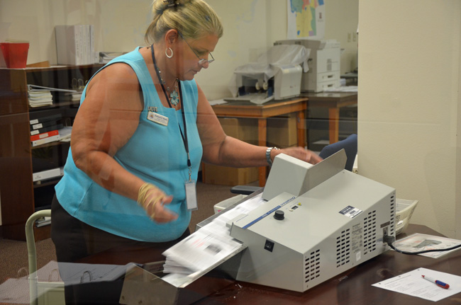 Accuracy, anyone? Supervisor of Elections Kimberle Weeks during a Canvassing Board operation today. (© FlaglerLive)