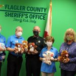 Members of the Kiwanis Club with Flagler County Sheriff Rick Staly and the Kiwanis's latest donation of stuffed bears. (Kiwanis)