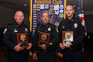 From left, Officer Johnny Bingham, Deputy Frank Barbagallo and Officer Tully(not pictured, Officer Shane Groth). (Palm Coast Observer)