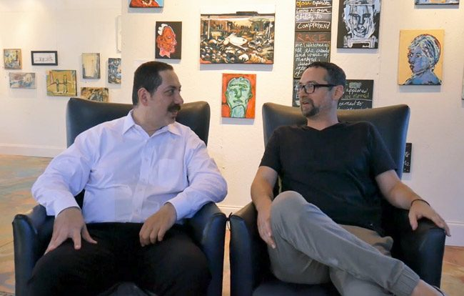 The art of entrepreneurial synergy: Office Divvy's Ky Ekinci, left, with Salvo Art Project's JJ Graham, at Graham's gallery. See the video of their conversation below.