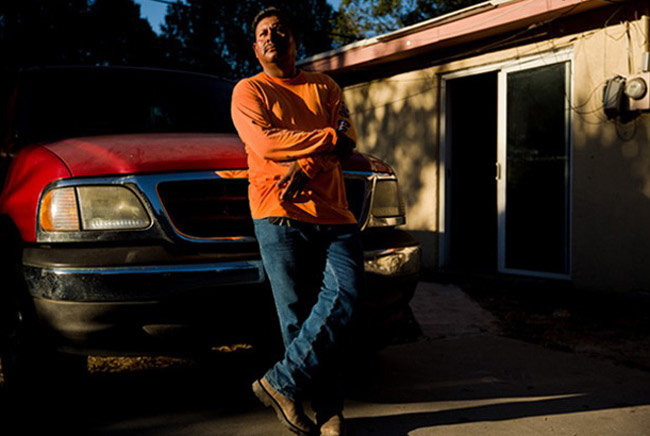 Juvenal Dominguez Quino sprained his knee when a trench collapsed at his construction job and was arrested for providing a false Social Security number to receive workers' compensation benefits. (Scott McIntyre for ProPublica)