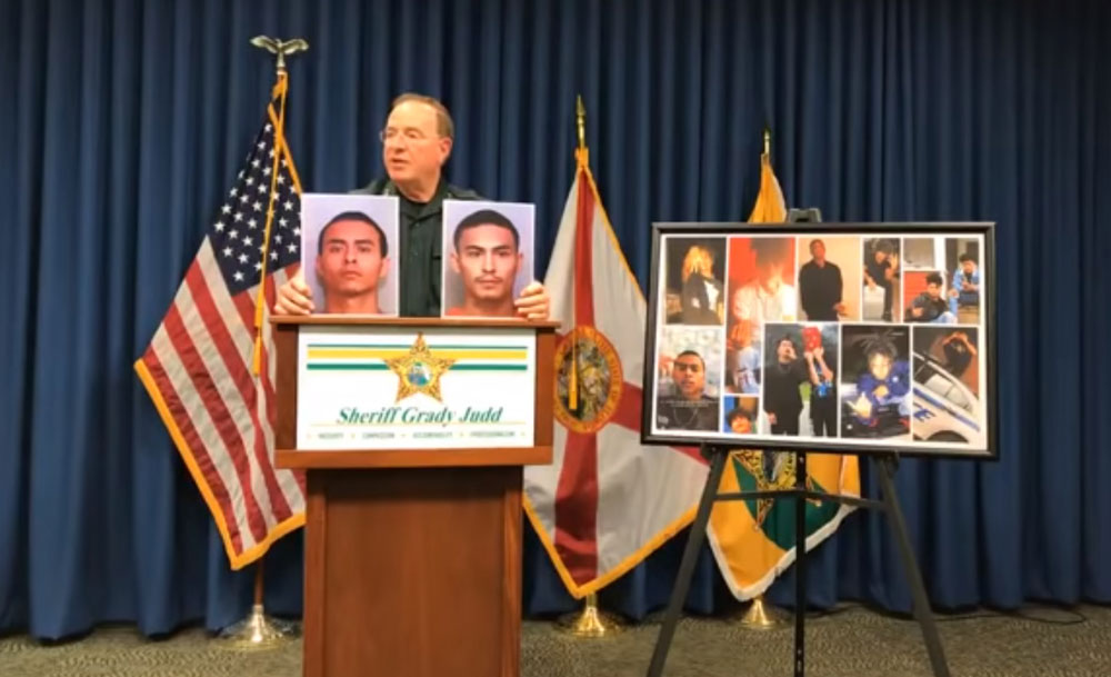 Polk County Sheriff Grady Judd with images of the two Lobato brothers after they were charged with first-degree murder in the death of Danne Frazier, 21. (© FlaglerLive via YouTube)