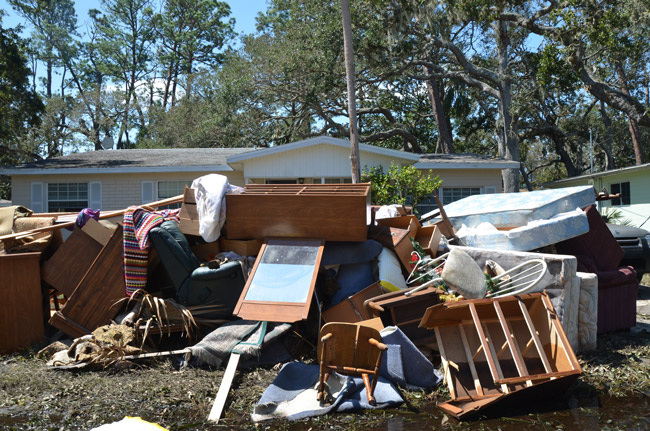 The damage on Lambert Avenue last September, a scene repeated through miles of streets along the Intracoastal in Flagler Beach. (© FlaglerLive)