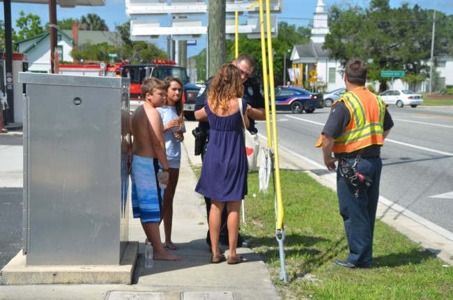Jasmine Lampley talks to police at the scene as her two passengers, a 13-year-old girl and 11-year-old boy, stand by. Click on the image for larger view. (© FlaglerLive)