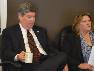 The body language says it all: relations between City Manager Jim Landon and Council member Heidi Shipley have not been smooth. (© FlaglerLive)