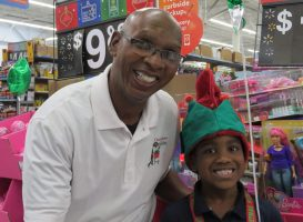 Larry Jones with one of the children in a 2018 shopping spree. (Facebook)