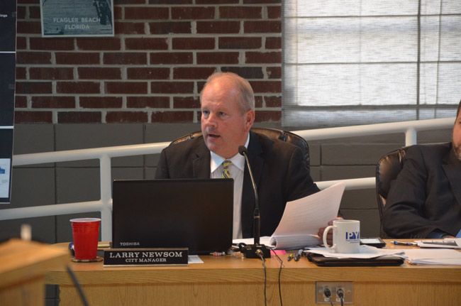 Flagler Beach City Manager Larry Newsom's tenure has been defined by Hurricane Matthew, a challenge he met head on. The commission today signaled its intention ton reward him substantially. (© FlaglerLive)