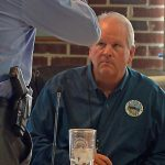 Flagler Beach City Manager Larry Newsom speaking to his police chief at a recent meeting. (© FlaglerLive)