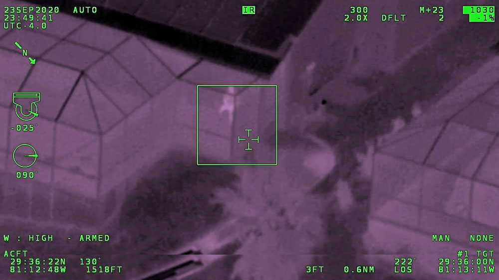 A man identified as Gregory Marr is accused of pointing a laser light at Air One, the emergency helicopter, as it was looking for another individual who'd fled police. Marr faces a third-degree felony charge. (Air One video)