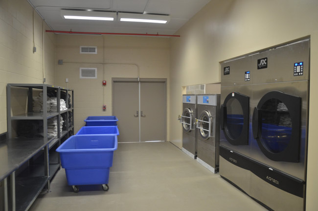 The laundry room at the Flagler County jail. Allegations of misconduct by deputies involved female inmates working laundry duty. (© FlaglerLive)