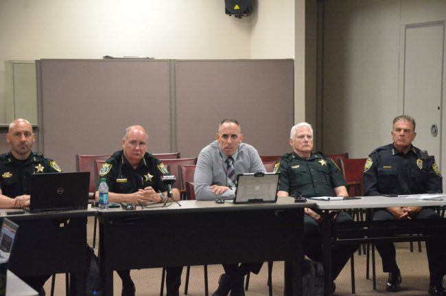 Don't mess with Flagler: from left, Chief Chris Sepe, Sheriff Rick Staly, Chiefs Paul Bovino and Mark Strobridge, and Bunnell Police Chief Tom Foster. Click on the image for larger view. (© FlaglerLive)