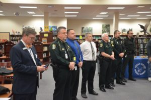 School district spokesman Jason Wheeler, left, aside, there were almost as many law enforcement officers in attendance as reporters. Click on the image for larger view. (© FlaglerLive)