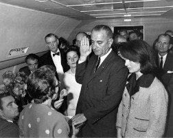 LBJ taking the oath after the assassination, with Jackie Kennedy to his left. Click on the image for larger view.