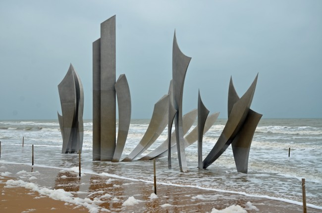 'Les Braves,' on Omaha Beach, a monument installed there in 2004 to commemorate the 60th anniversary of the D-Day landing.  Click on the image for larger view. (© FlaglerLive)