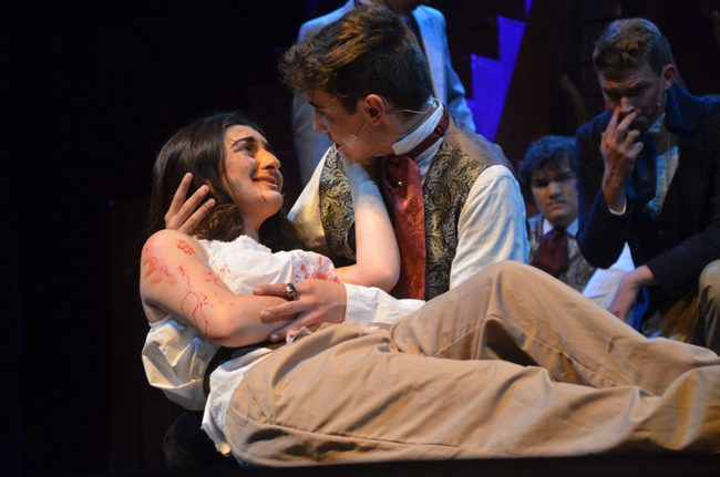"Elana Sobhani as the dying Eponine and Gabriel Auletti  as Marius in the Flagler Palm Coast High School Thespians' production ""Les Miserables,"" opening tonight at the Flagler Auditorium. The musical is directed by Kelly Rivera. See details below. (c FlaglerLive)"