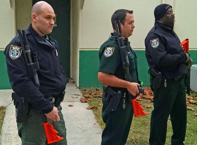 From left, Flagler County Sheriff's deputies Daniel LaVerne,  Craig Rossi and Jason Williams during training with shotguns equipped for less-lethal munitions.