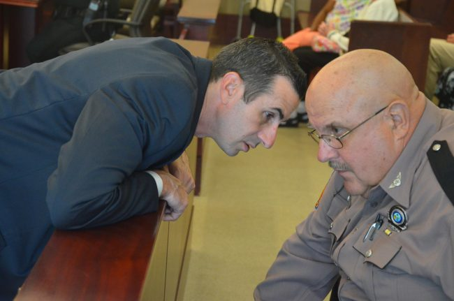 Assistant State Attorney Jason Lewis, who prosecuted the case, left, with Cpl. Pete Young, the Florida Highway Patrol Traffic Homicide Investigator who handled the case, and who testified today. (c FlaglerLive)