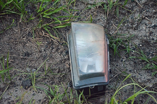 One of the Lexus's headlights, yards from the wreck. Click on the image for larger view. (© FlaglerLive)