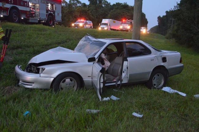 The Lexus was catapulted into a ditch on the north side of SR100. Click on the image for larger view. (© FlaglerLive)