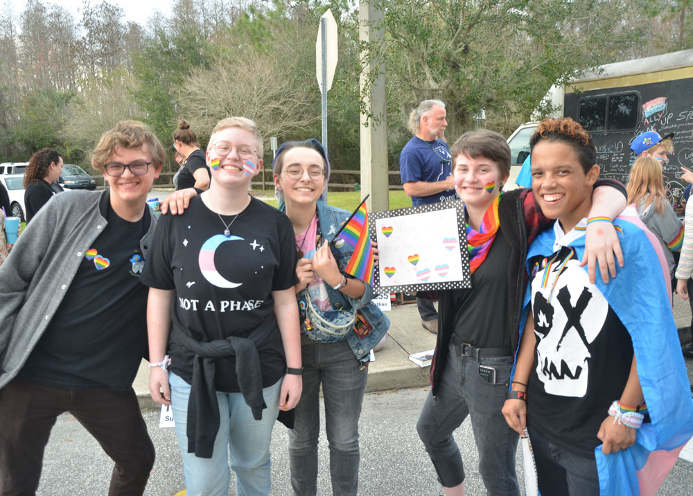 Some of this evening's demonstrators for LGBTQ rights and protections in schools, from left, Jonas Winter, a 10th grader at Matanzas High School, Elliott Bertrand, a 10t grader at Flagler Palm Coast High School, Dmitri Marve, 12th grader at Matanzas, Lylia Demais, 7th grader at Buddy Taylor Middle School, and Takota Kokoun, 23, in college, formerly of Flagler schools. (© FlaglerLive)